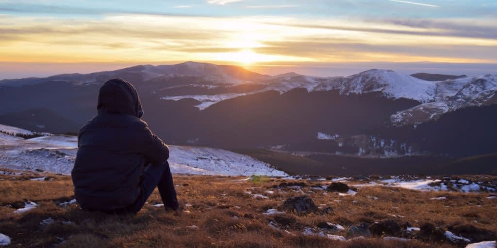 person meditating on pushing forward when life is tough
