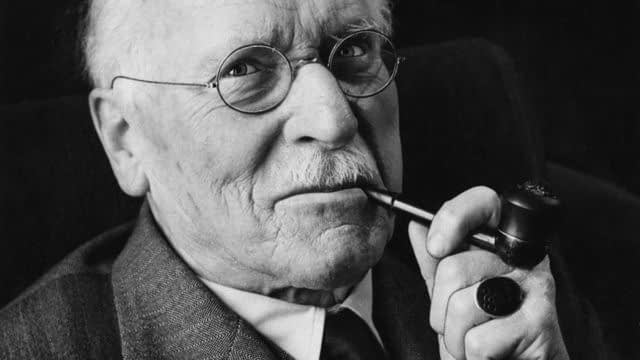 Carl Jung smiling about his 5 factors to live a happy life